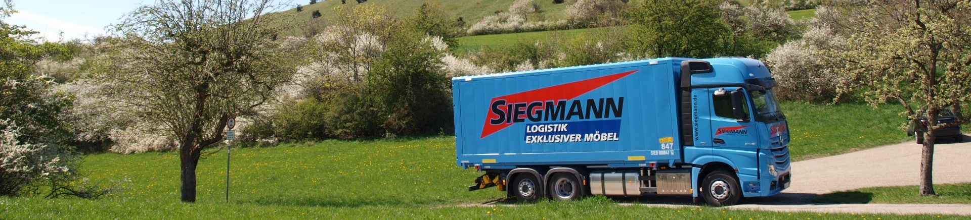 Siegmann Lkw unterwegs auf dem Land
